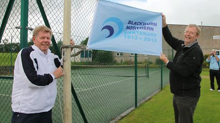 Former GB Number 1 and Davis Cup tennis player Mark Cox helping to raise the Centenary Flag with Bla
