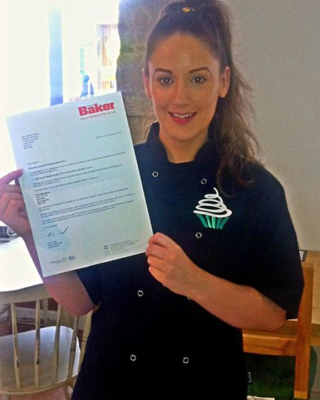 Head baker, Natalie Owens with the confirmation letter