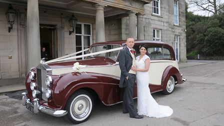 Usha and Lee with a classic 1937 Rolls-Royce outside Haigh Hall