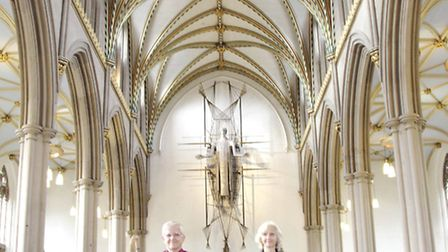 Bishop Julian and his wife Heather enter the cathedral