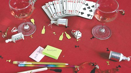 Party games picture for EDP Norfolk Magazine with playing cards and dice.