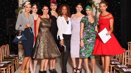 Models with stylist Nikki Chima (centre)