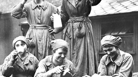 Women workers in an Oil and Cake factory having tea, Lancashire, 1918. Oil cakes were used to feed c