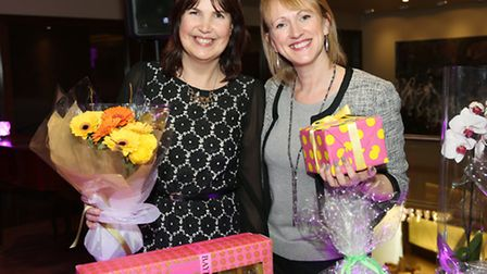 Zoe Rothwell and Christina Cope of Pendleside Hospice with some raffle prizes