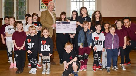 David Howard, Trustee for West Cornwall Youth Trust, presenting the cheque to the team and some of t