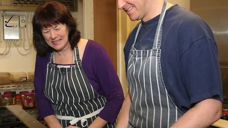 Philippa James and Jamie Palmer in the kitchen