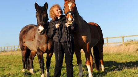 Suzanne Cooke, chaplain to the Royal Norfolk Agricultural Association, with her ponies, Bernie, left