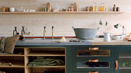 The Osea Kitchen' by Plain English Cupboards painted in 'Coal Scuttle' & 'Rusty Nail' devised by Ad