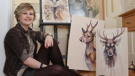 Katie Hampson with a selection of her watercolour paintings with mixed media