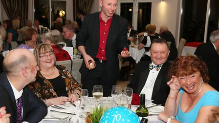 Magician entertains the guests during the evening