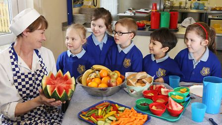 School cook, Katrina Fraser, with Reception Class youngsters, Izzy Mason, Darci Shaw, Vinnie Langm