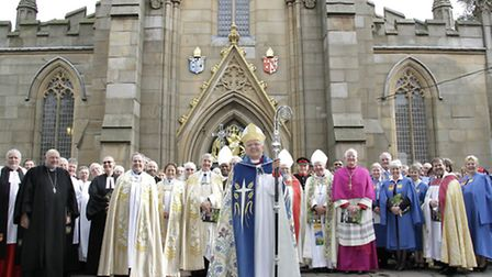 The new Bishop stands with clergy and civic dignitaries at the West Door after the service