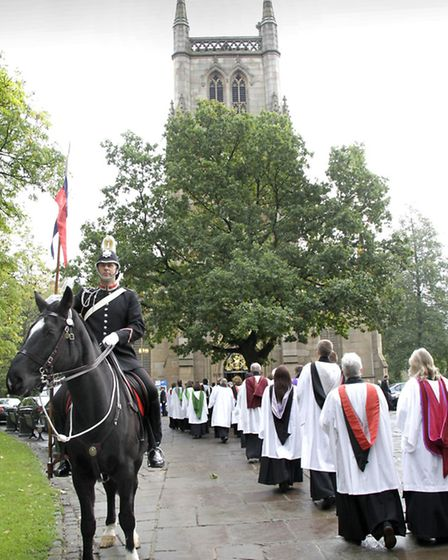 The clergy procession enters the cathedral