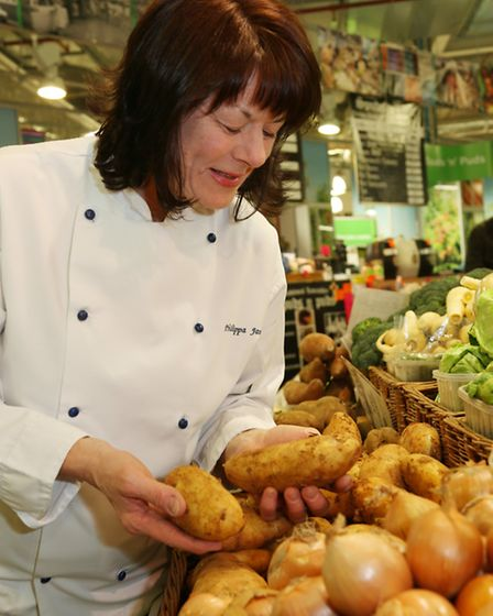 Looking at the potatoes at Scott Stewart's Fruit and Veg stall