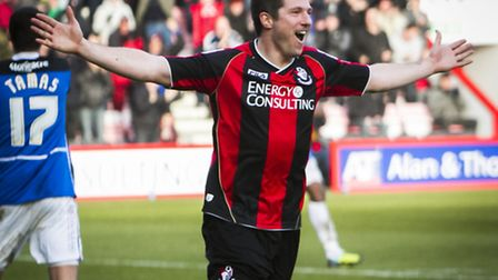 AFC Bournemouth's new striker Yann Kermorgant celebrates his hat trick on his first home debut - Ant