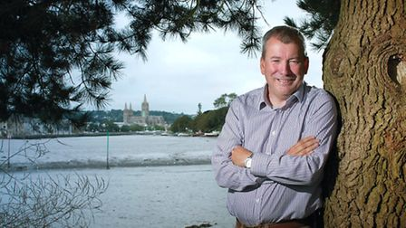 Malcolm Bell - Head of Tourism (Truro) With Truro Cathedral in the back ground