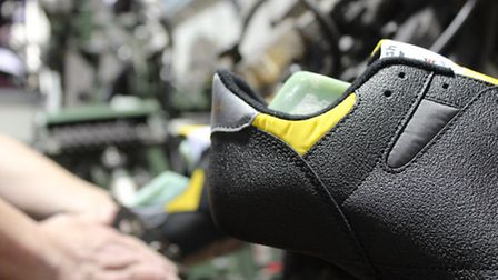 Shoes being manufactured in the factory