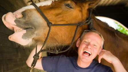 Martin Clunes with one of his magnificent Clydesdales
