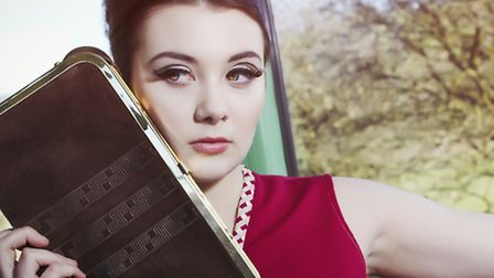 The burgundy school dress is £35 and the brown suede clutch is £30