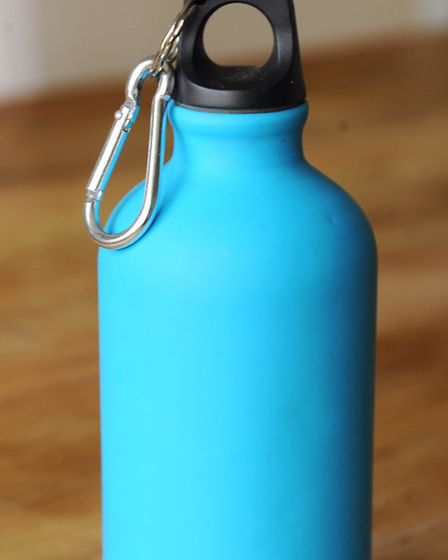 The contents of Gaye Youngman's bag when she visited Uganda. Water bottle. Picture: Denise Bradley