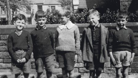 Ray, fourth from left in the tie, with friends during his time in Wales