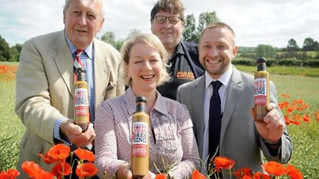 Left to right: Major-General Tony Pollard (formerly Royal Leics. Regiment) with owners of Scarlett &