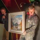 Garry Batt (Dukes of Dorchester), with a paint spatter David Atkins, auctions off his painting done