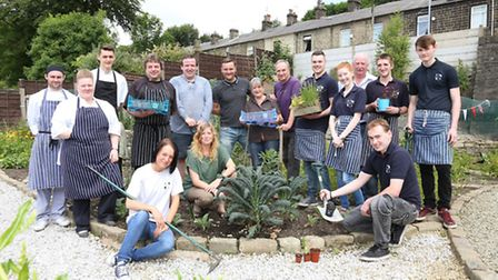 Glen Duckett of the Eagle and Child with staff and members of Incredible Edible in the Incredible Ed