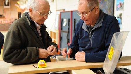 Men learning practical skills at the new project, Norwich Men's Shed. George Michie, left, and Julia