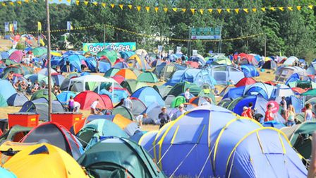 Latitude at Henham Park in Suffolk. People arriving in the sunshine to set up camp on the first day