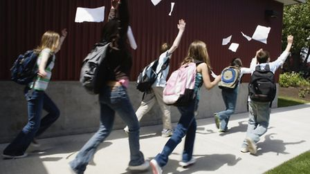Group of Students Outside Building Throwing Away Papers