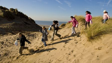 A group of yougsters from Astley exploring the sand dunes