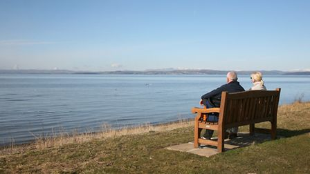 Two visitors look out over Morecambe Bay (PM)