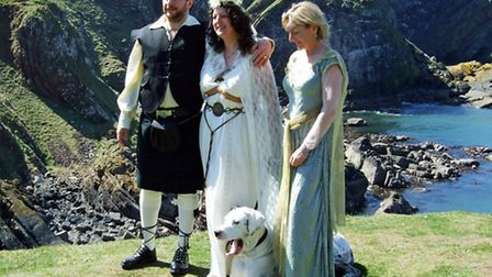 Sarah and Ian at their Wiccan wedding with Bramble as ring bearer