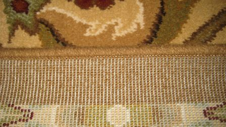 Machine-made rugs tend to have thick backing