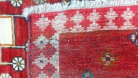 Hand-made rugs have visible rows of knots
