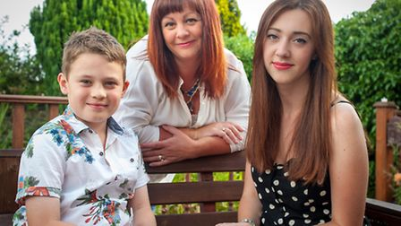Cathy Cookson at home with her children Connor, eight, and Molly, 18. Photo: Bill Smith for EDP Norf