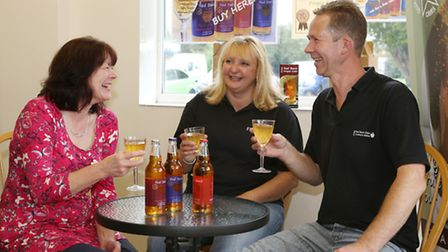 Philippa James sits discussing the cider with Anita and Lee