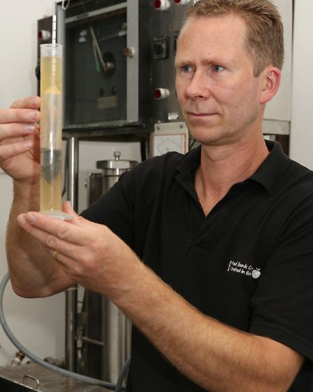 Lee takes a reading from the hydrometer