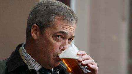 Brexit Party leader Nigel Farage sips a pint in a pub. Photograph: Owen Humphreys/PA.