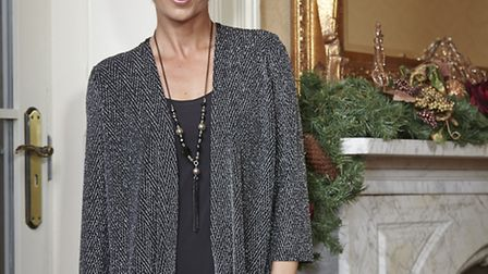Ideal for Christmas day, you can stay warm as well as stylish with this silver two in one top with n