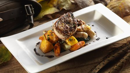 Pot roast pheasant with root vegetables and black cabbage