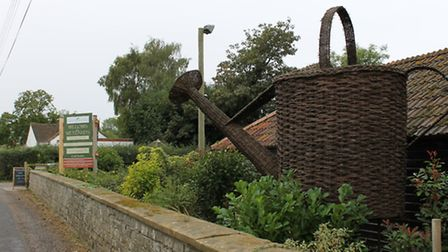 A giant watering can at the entrance in Stoke st Gregory