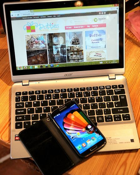 Samsung Galaxy S4 mobile phone and Acer laptop