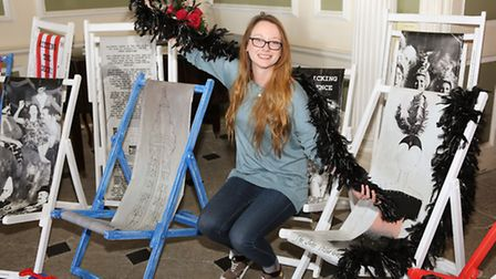 Community Heritage Assistant, Laura Brennan presents a display of seaside deckchairs to promote Blac