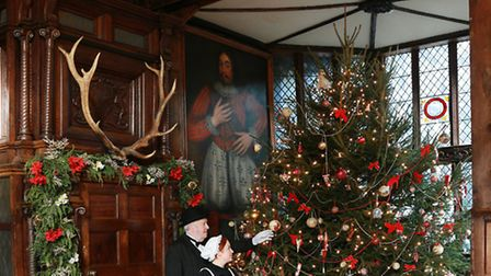 Speke Hall Christmas; The Great Hall with staff members in Victorian costume Dave Pope (butler) and