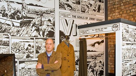 Mike Stoll beside a blow-up of the Victor comic strip