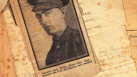 A newspaper clipping about his heroism