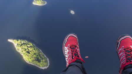 St Herberts and Rampsholme Islands in Derwentwater with Stuarts red boots