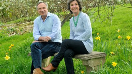 Mark and Fenella on a stone seat in the garden they created themselves © Peter Booton Photography